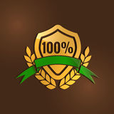 Gold quality mark with Green ribbon Royalty Free Stock Image