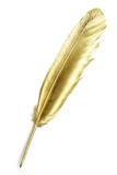 Gold quill. Unusual gold quill pen on a white paper Royalty Free Stock Photos