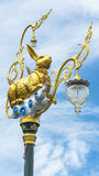 Gold rabbit lamppost. The gold rabbit lamppost in front of the sky Stock Photos