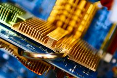 Gold radiator. On blue videocard Royalty Free Stock Image