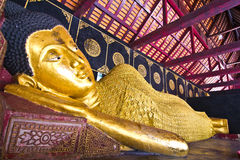Gold Reclining Buddha Royalty Free Stock Image