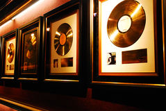Gold Records on the Wall Stock Images