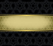Gold rectangular frame on a black background Stock Image
