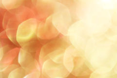 Gold and red abstract bokeh lights, defocused background Stock Photos