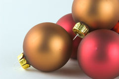Gold and red balls alpha. Gold and red Christmas ornaments royalty free stock images