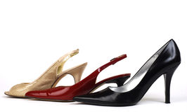 Gold, Red, and Black Women's High-Heel Shoes Royalty Free Stock Photos