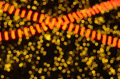 Gold and red bokeh Stock Photography