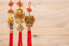 Gold and red Chinese new year decoration on wooden background Royalty Free Stock Photo