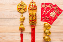 Gold and red Chinese new year decoration on wooden background Stock Photography