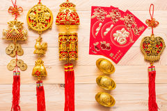 Gold and red Chinese new year decoration on wooden background Stock Photos
