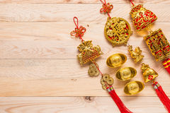 Gold and red Chinese new year decoration on wooden background Stock Image