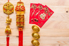 Gold and red Chinese new year decoration on wooden background Royalty Free Stock Images