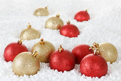 Gold and red Christmas ball, decoration on the snow Stock Photos