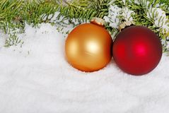 Gold and red christmas ball in the snow Stock Image