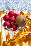 Gold and red christmas balls in martini wineglass Stock Image