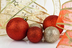 Gold and red Christmas baubles. Gold and red Christmas baubles with gold and red ribbon Stock Image