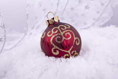 Gold red christmas decoration on white snow Stock Photography