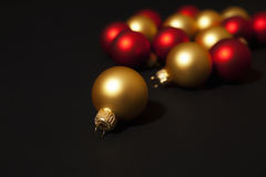 Gold and red christmas ornaments. On  black background Stock Photo