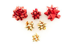 Gold and Red Christmas Wrapping Bows. Gold and Red Christmas Bows arranged in a heart shape Stock Photos