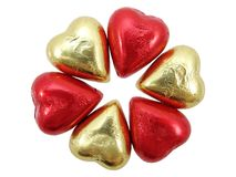Gold & Red Foil wrapped chocolate hearts 2 Stock Photo