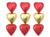 Gold & Red Foil wrapped chocolate hearts Royalty Free Stock Photos