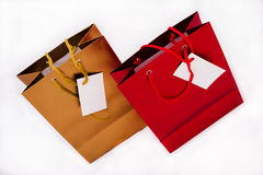 A gold and a red gift bag Stock Image