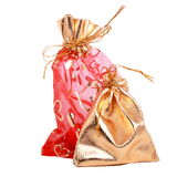Gold and red gift bags. Isolated on white background Stock Image