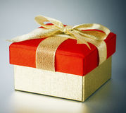 Gold and Red Gift Box with Bow Stock Photo