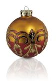 Gold Red Ornament. Fancy Christmas Ornament; red and gold macro with reflection royalty free stock photos