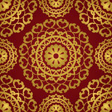 Gold and red pattern. Oriental seamless pattern of mandalas. Vector gold ornament on a red background. Template for shawl, textile, carpet Stock Images
