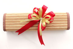 Gold and red ribbon bow with giftbox on white background Royalty Free Stock Image