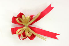 Gold and red ribbon bow on white background Stock Photography