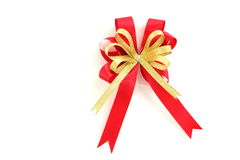 Gold and red ribbon bow on white background Stock Images