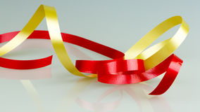 Gold and Red Ribbon String Royalty Free Stock Photo
