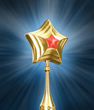Gold and red star on black background Stock Photography