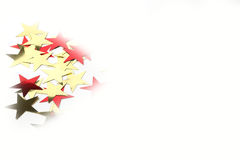 Gold and red stars. Metallic gold and red stars on a white background with faded edges perfect for Christmas or parties Royalty Free Stock Photos
