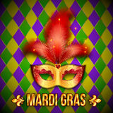 Gold and red vector carnival mask on colorful grid Stock Images