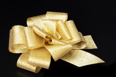 Gold ribbon. On a black background Stock Images