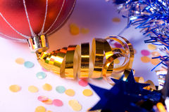Gold Ribbon. Christmas Decorationred - gold ribbon, tinsel, confetti Royalty Free Stock Photo