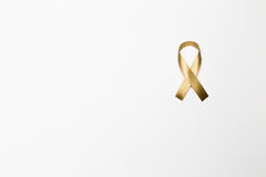 Gold ribbon as symbol of childhood cancer awareness isolated on Royalty Free Stock Photos