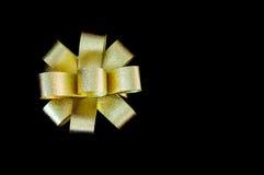 Gold Ribbon On Black Background. Gold Ribbon On Black Isolate Background Stock Photography