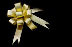 Gold Ribbon On Black Background. Gold Ribbon On Black Isolate Background Royalty Free Stock Images