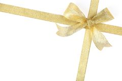 Gold ribbon with bow. On white Royalty Free Stock Photography