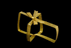 Gold ribbon with a bow. Isolated Royalty Free Stock Image
