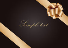 Gold ribbon with bow Royalty Free Stock Photography