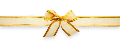 Gold ribbon with bow. Gold gift ribbon with bow Royalty Free Stock Photo