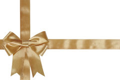 Gold ribbon with bow. Isolated on white background Stock Images