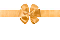 Gold ribbon and bow. Gold silk ribbon and bow on white Royalty Free Stock Photography