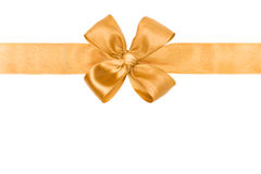 Gold ribbon and bow. Gold silk ribbon and bow on white Stock Photos