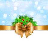 Gold ribbon,  bow and holly berry on blue background. Stock Photography